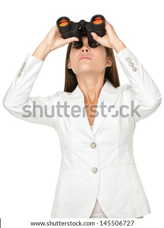 Young businesswoman looking through binoculars isolated on white background - stock photo
