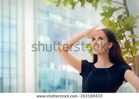 Young Businesswoman Looking Up  and Searching for Something - Elegant woman in central urban decor looking forward for the future  - stock photo