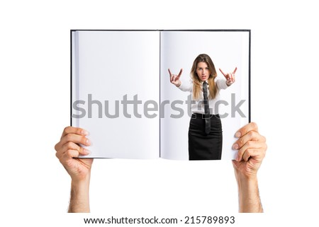 young businesswoman making horn gesture printed on book - stock photo