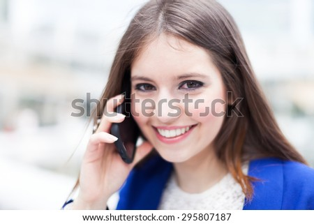Young businesswoman on the phone outdoor - stock photo