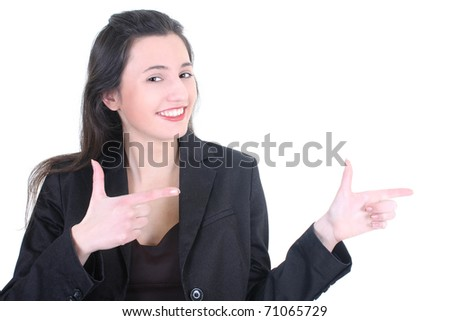 Young businesswoman pointing at copy space over white - stock photo