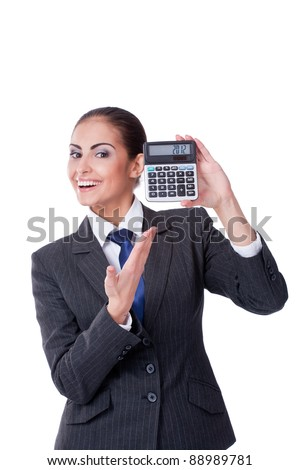Young businesswoman pointing into calculator with 2012 text - stock photo