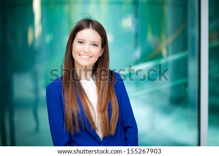 Young businesswoman portrait in an urban setting - stock photo