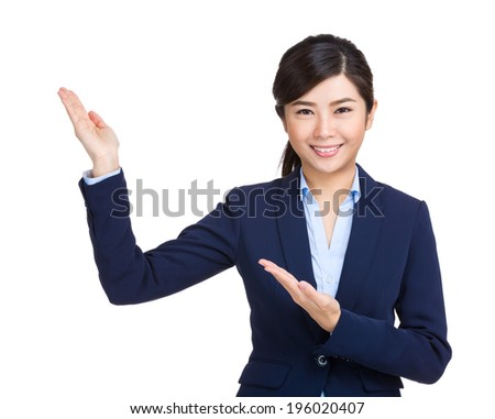 Young businesswoman presenting by hand - stock photo
