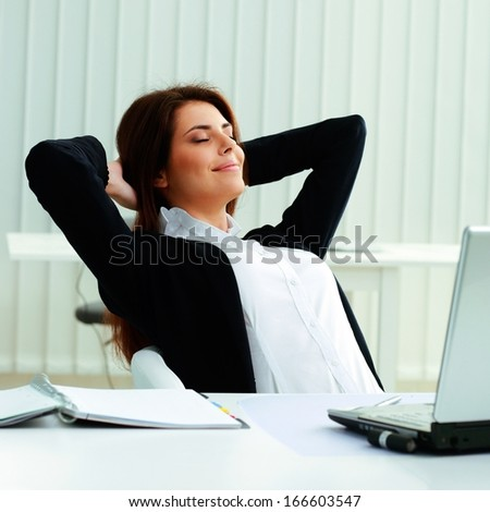Young businesswoman resting in office - stock photo
