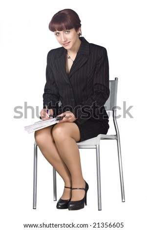 Young businesswoman, secretary or student with pen isolated on white - stock photo