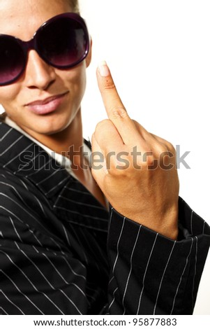 young businesswoman showing middle finger, isolated on white background - stock photo