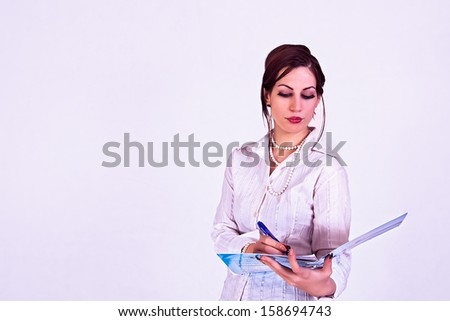 young businesswoman signing a contract - stock photo