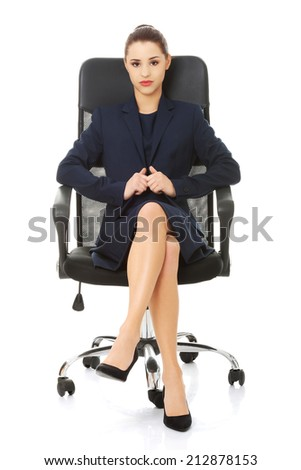 Young businesswoman sitting in chair. - stock photo