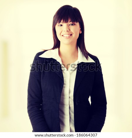 Young businesswoman smiling - stock photo