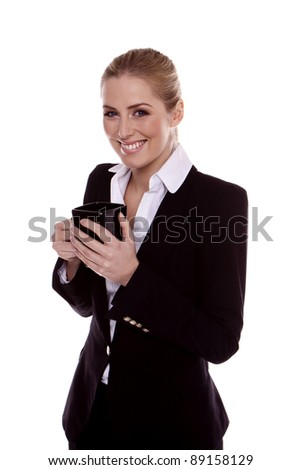 Young businesswoman standing and holding a cup on a white background. Coffee break. - stock photo