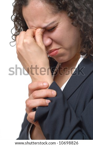 Young businesswoman stressed out at the office - stock photo