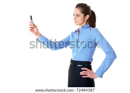 young businesswoman takes photo using her mobile phone, isolated on white background - stock photo