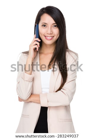Young businesswoman talk to cellphone - stock photo
