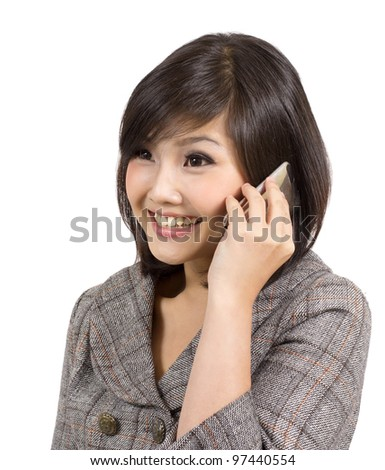 young businesswoman talking on cellphone - stock photo
