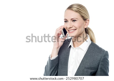 Young businesswoman talking on her cell phone  - stock photo