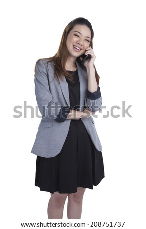 Young businesswoman talking on mobile phone. Beautiful young multiracial Chinese Asian / caucasian xwoman talking on her cellphone. Isolated on white background. - stock photo