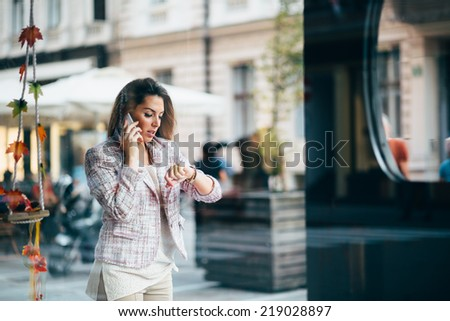 Young businesswoman talking on the phone on street - stock photo