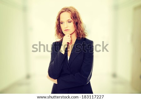 Young businesswoman thinking - stock photo