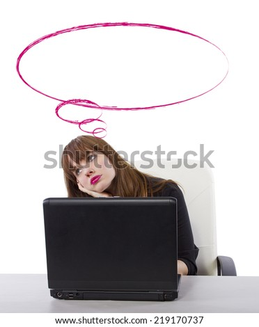 young businesswoman thinking or contemplating while at work - stock photo