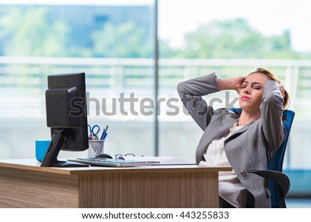 Young businesswoman tired after long working day - stock photo