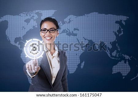 Young businesswoman touching futuristic touchscreen on blue world map background - stock photo