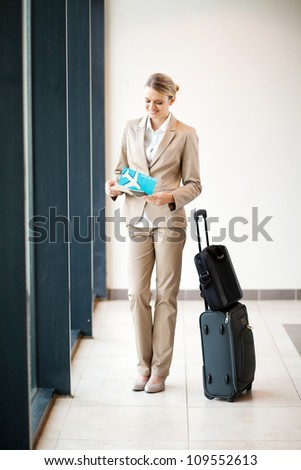 young businesswoman waiting her flight at airport - stock photo