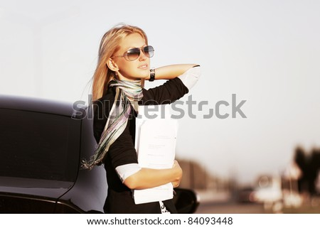 Young businesswoman with a car - stock photo