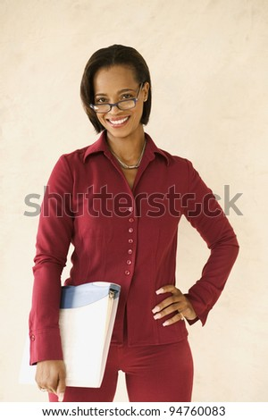 Young businesswoman with binder - stock photo