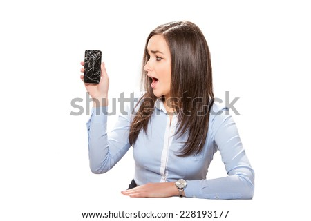 Young businesswoman with broken smartphone. - stock photo