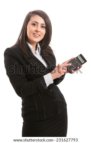 Young businesswoman with calculator - stock photo