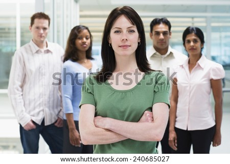 Young Businesswoman with Co-Workers - stock photo