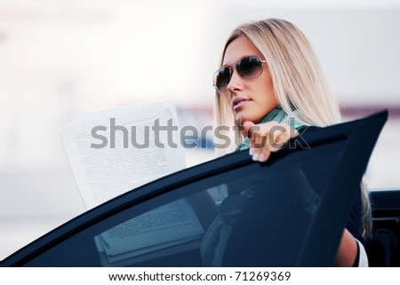Young businesswoman with financial reports - stock photo