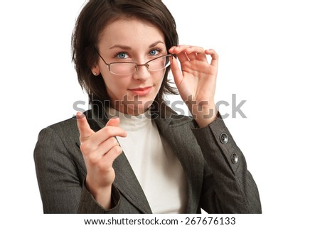 young businesswoman with glasses in hand pointing a finger - stock photo