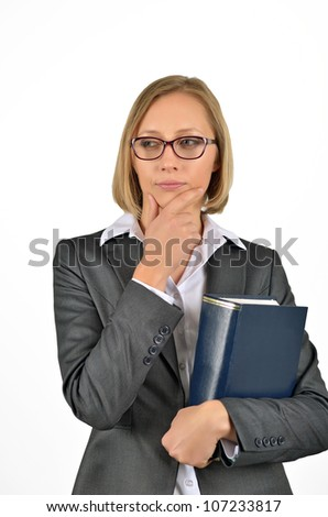 Young businesswoman with glasses thinking looking up holding a book. Isolated on white - stock photo