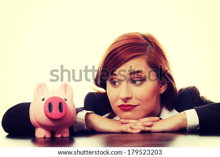 Young businesswoman with her piggy bank.  - stock photo
