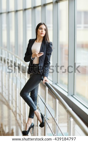 Young businesswoman with mobilephone.  - stock photo