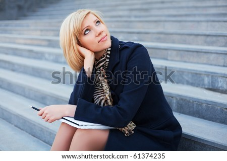Young businesswoman with notebook. - stock photo