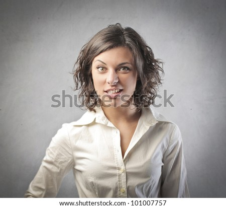 Young businesswoman with perplexed expression - stock photo