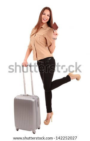 Young businesswoman with suitcase isolated on white - stock photo