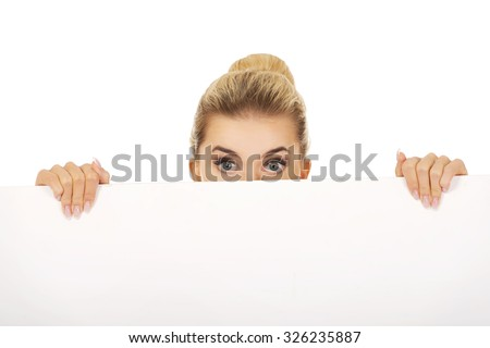 Young businesswoman with surprised eyes. - stock photo