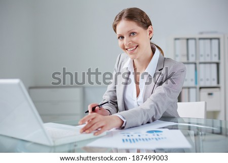 Young businesswoman working in office - stock photo