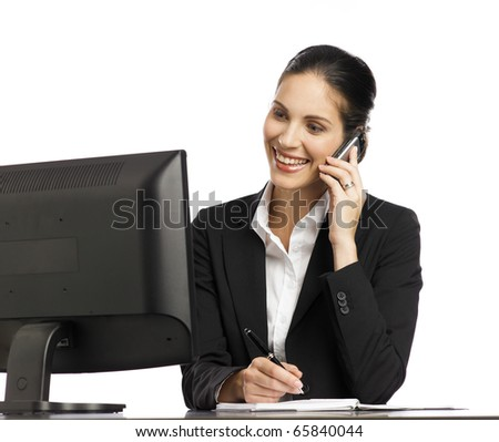 Young Businesswoman working with telephone and computer - stock photo