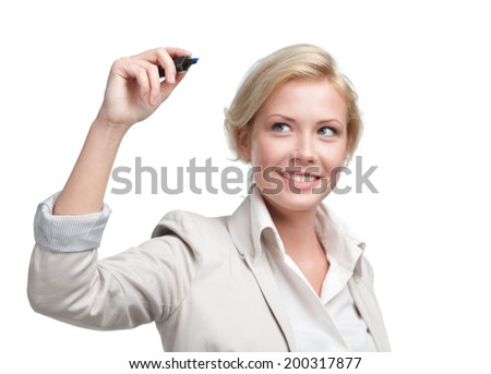 Young businesswoman writing on the invisible screen with marker, isolated on white. Leadership concept - stock photo