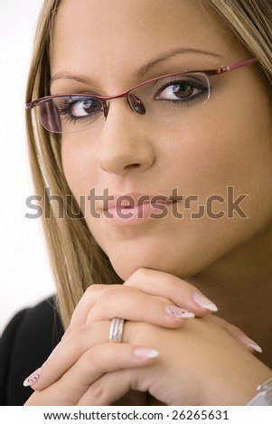 Young businesswomen wearing glasses. Thinking, leaning on hands, looking at camera.Isolated on white background. - stock photo