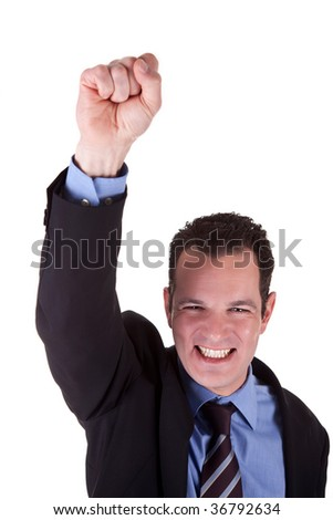 Young bussiness man with arm raised in victory sign - stock photo