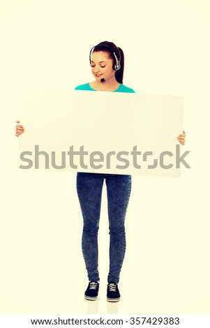 Young call center woman with billboard. - stock photo