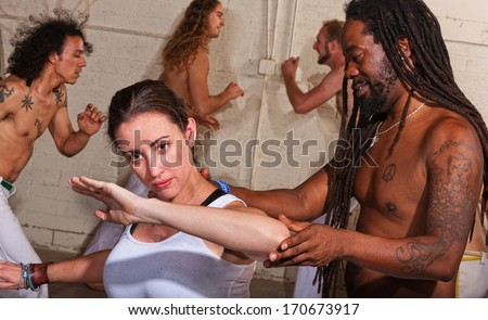Young capoeira student with handsome instructor - stock photo
