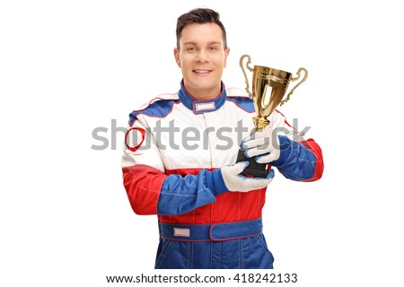 Young car racing champion holding a gold trophy and looking at the camera isolated on white background - stock photo