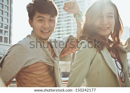 Young carefree couple laughing - stock photo